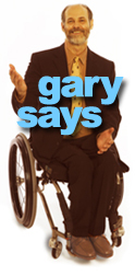 Gary Karp in his wheelchair gesturing with a smile